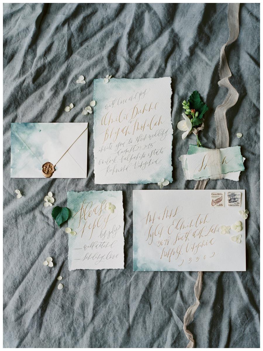 exquisite wedding invitation suite on blue watercolor deckle ed