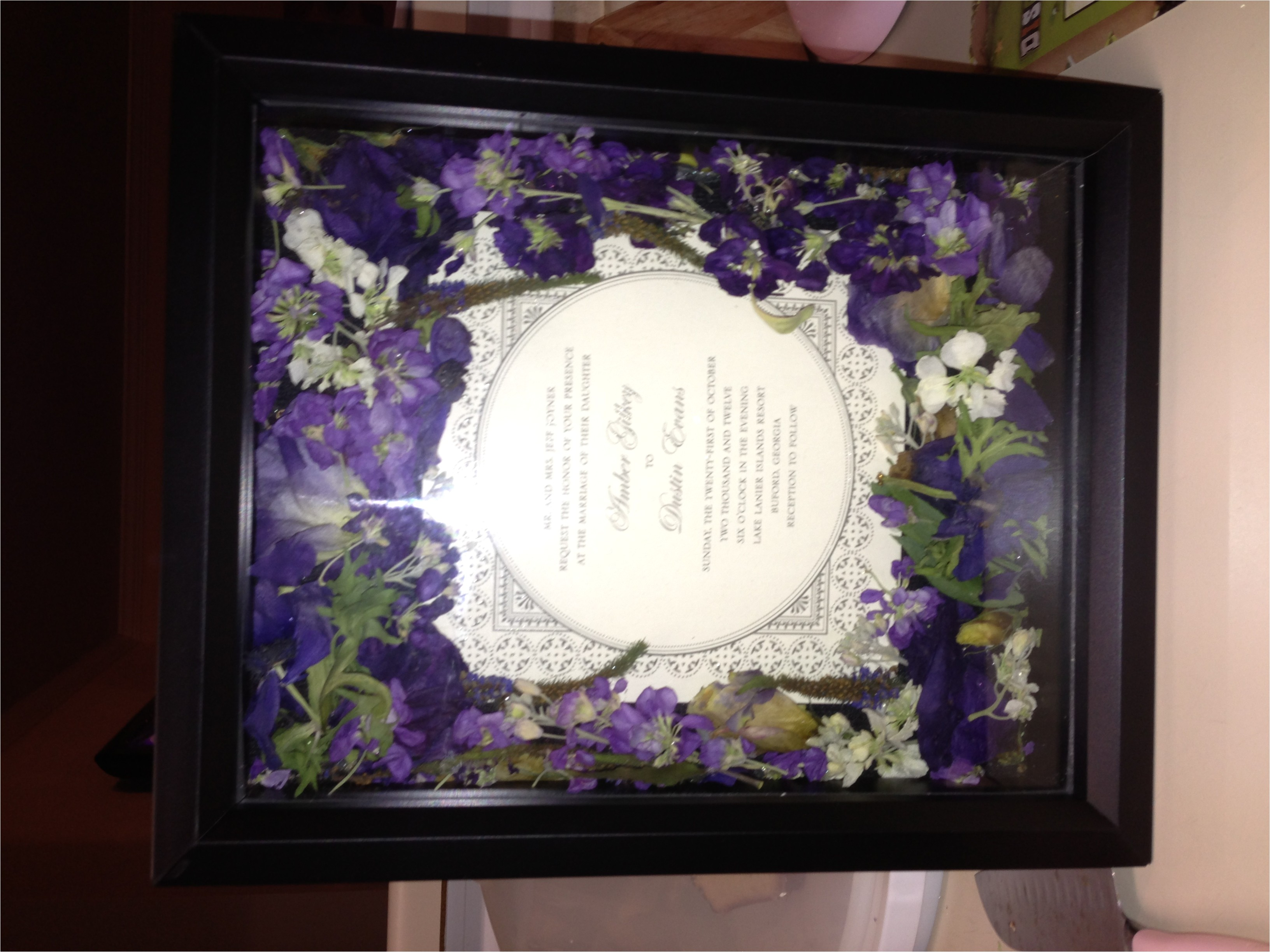 i used a shadow box silica gel and my wedding invitati