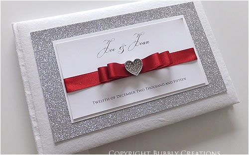 silver glitter wedding invitations with red ribbon