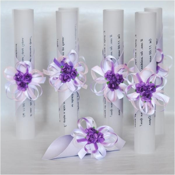 wedding invitation roll with white roses and purple ribbon