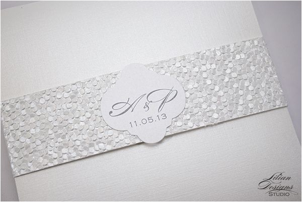 custom pocket invitation with pebble textured paper band and label