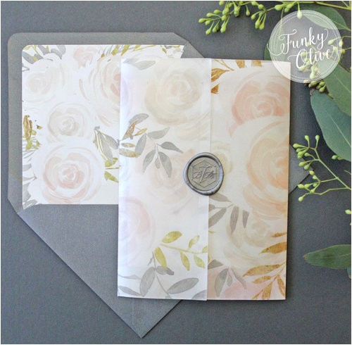 watercolor floral vellum wrap invitation suite with steel grey wax