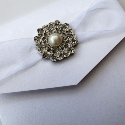 vintage chandelier pocketfold wedding invitation with large diamante pearl brooch