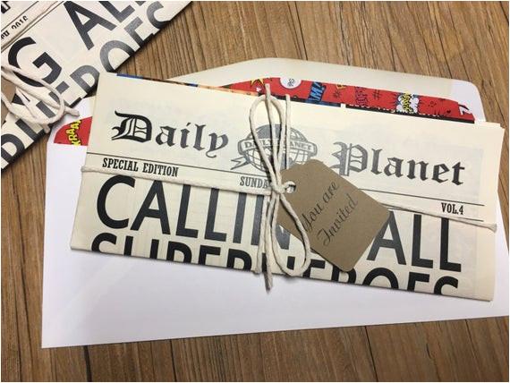 newspaper invitation superhero